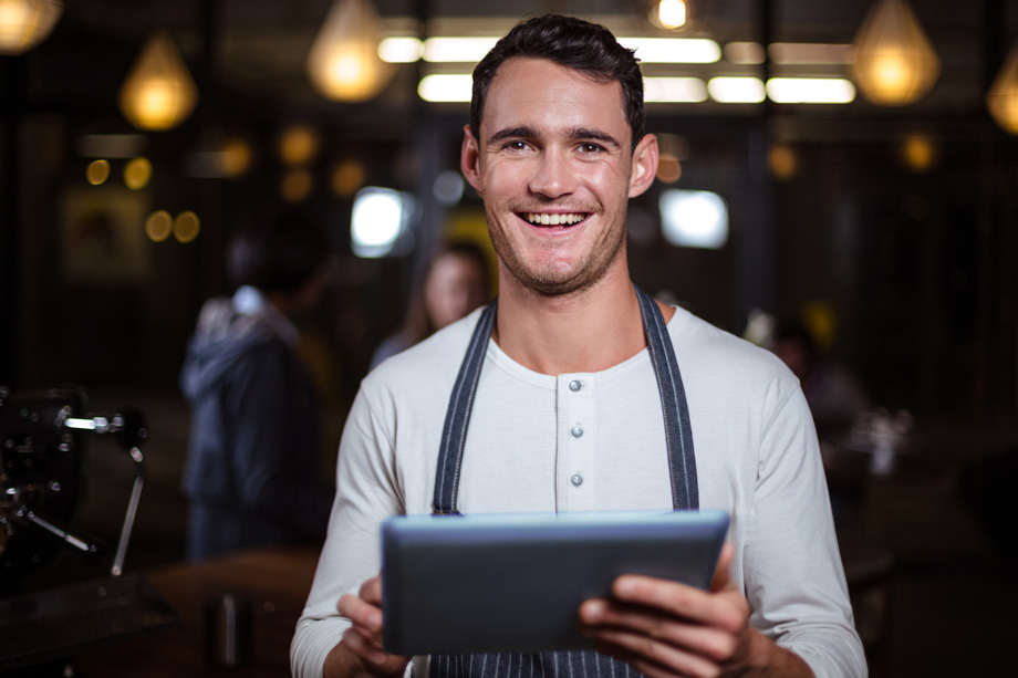 Restaurant staff enjoys using mobile restaurant POS on a tablet